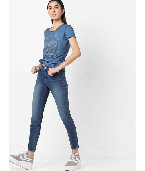 Women's skinny fit medium wash Star motion jeans