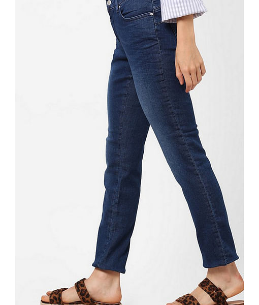 Women's medium wash slim fit Britty up motion jeans
